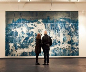 Meghann Riepenhoff, Littoral Drift Nearshore #209 (Springridge Road, Bainbridge Island, WA 02.12.2015, Fletcher Bay Water Poured and Fletcher Bay and Fay Bainbridge Silt Scattered), grid of unique cyanotypes, each 19 x 24 inches, totaling 114 x 216 inches.